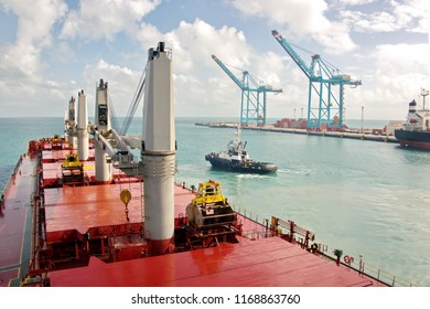 Mooring operations of a cargo ship using the assistance of tugboats in the port of Pecem, Brazil. June 2017.