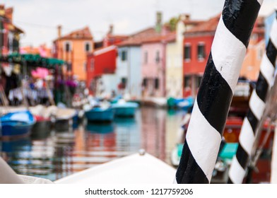"""Mooring pole (""""palina"""" in Venetian) in a canal of Burano. It is the typical mooring used in the Venice lagoon for mooring boats, including gondolas"""