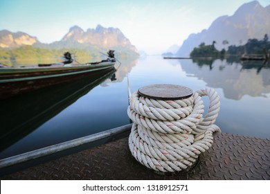 Mooring rope and bollard on sea water, rope for mooring a vessel is adhered to a pier
