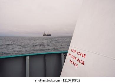 mooring safety onboard ship or vessel. snapback zones danger sign on mooring station. work at sea