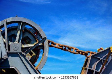 Mooring winch, Mooring winch lass Chain big with rusty at ship forward on forecastle deck front of ship.