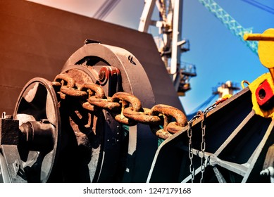 Mooring winch, Mooring winch lass rope anchor at ship forward in shipyard of large with Big Chain and rusty with blue rope in drum.
