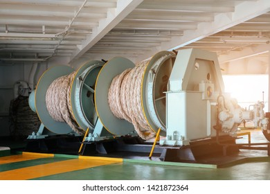 Mooring winch or Mooring windlass during ship moored in port with winch rope in drum.