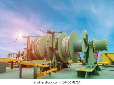 Mooring winch or Mooring windlass and rope in drum on main deck of Oil Tanker ship on blue sky, Mooring winch of large vessel with winch rope in drum.