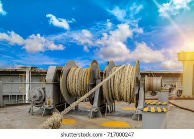mooring winches on deck for container ship, forward mooring winch rope on blue sky background.