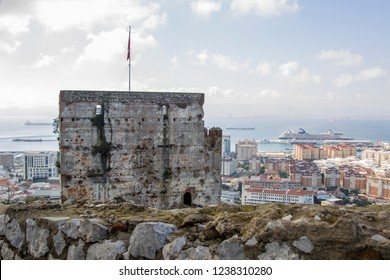 The Moorish castle on the British enclave Gibralter with the English flag and view of the Spanish mainland