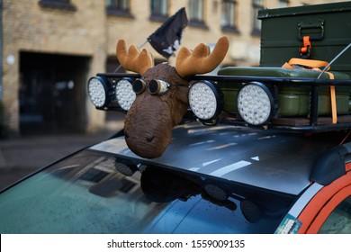 Moose figure at teh roof of car