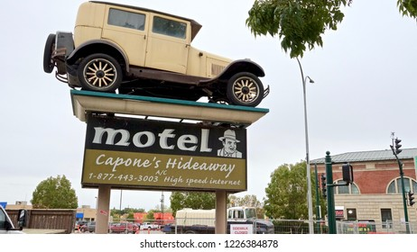Moose Jaw,  Saskatchewan  / Canada - September 13 2018: Capone's Hideaway Motel vintage sign topped with  vintage Packard car