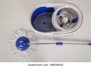 mop and blue bucket for cleaning the floor