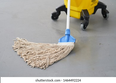 Mop and bucket, janitorial service.