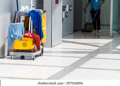 Mop bucket on cleaning in process and worker background