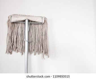 mop with cement wall background