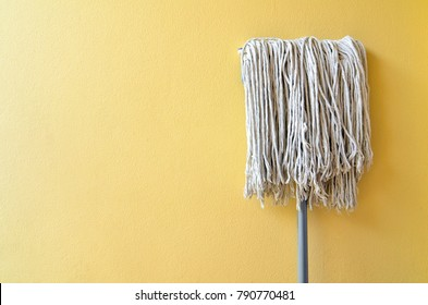 mop head at the wall after cleaning.