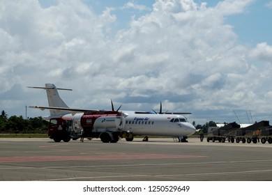 Mopah Airport, Merauke Papua, Indonesia, December 1st, 2018: Pertamina is refueling the Trigana Air plane at airport