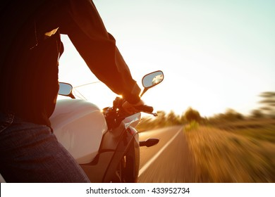 Moped drivers on road at sunset - Concept motorcycle for tourist