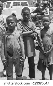 MOPTI, MALI - 19 June 2015: An image black african children standing outside with sad face