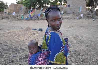 Mopti, Mali - December, 31, 2014: Local Fulani woman carries her child