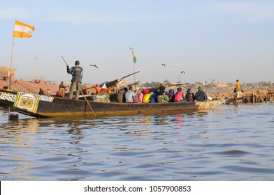 Mopti, Mali - December, 31, 2014: African man pinnace navigating the river Niger in Mopti, most important commercial port of Mali