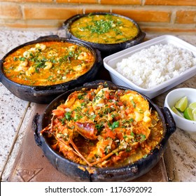 Moqueca of lobster, moqueca capixaba and bobó of shrimp, delicious Brazilian dishes.