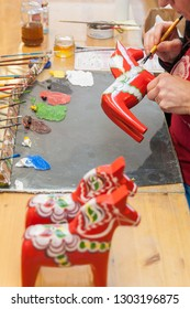 Mora, Sweden. 02/15/2017. The Dala Horse factories of Nusnäs. In a workshop and manufacturer shop of carved Dalecarlian Horse. Where Sweden's famous handicraft is made.