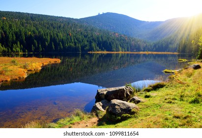 Moraine lake Kleiner Arbersee with mount Grosser Arber in National park Bavarian forest. Autumn landscape in Germany.