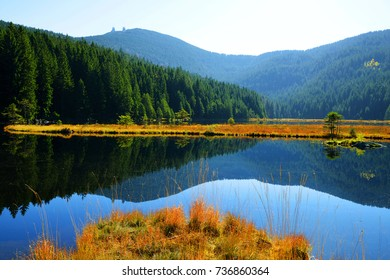 Moraine lake Kleiner Arbersee with mount Gross Arber in National park Bavarian forest. Autumn landscape in Germany.