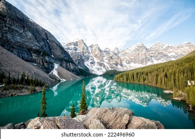 Moraine Lake with still water, viewed in early morning light