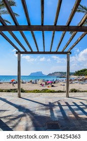 MORAIRA, ALICANTE/SPAIN – OCTOBER 6, 2017: Framed view of Playa de L'Ampolla beach with Peñón de Ifach in the background, Moraira, Costa Blanca, Spain.
