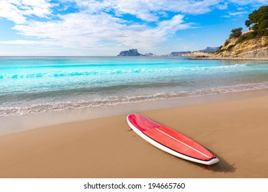 Moraira playa El Portet beach with paddle surfboard at Alicante Spain