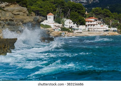 Moraira with sea vawes on  Costa blanca  Spain