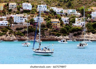 MORAIRA, SPAIN – JUNE 14. The beautiful anchorage in El Portet Beach close to the port of Moraira in Alicante is a perfect place to swim and diving all year, on june 14, 2017 in Moraira.