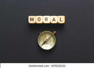 """MORAL-compass"" idiom spelled on blocks with vintage compass."
