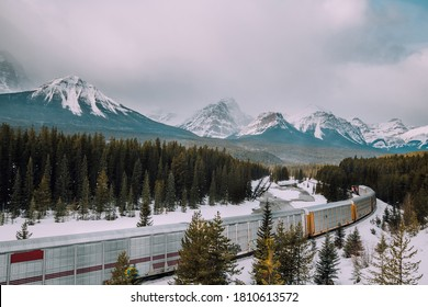 Morant's curve railway and train with Canadian Roakie mountains background