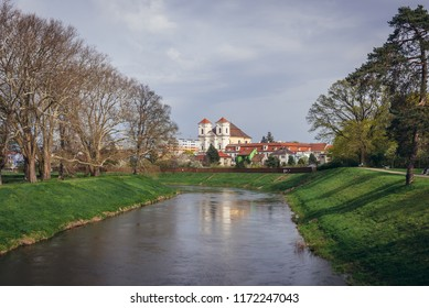 Morava River in Veseli nad Moravou, Czech Republic, view with monastery and church of Guardian Angel