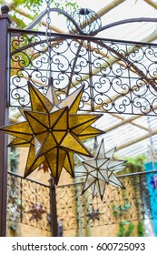 Moravian star ornament hanging in Moroccan courtyard