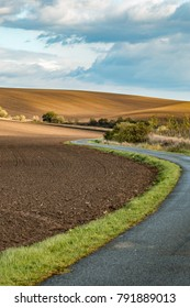 Moravian Tuscany autumn day cropped field clay corrugated road panorama with grass and mezema. a chapel and a big tree grows. Czech Republic.  - Shutterstock ID 791889013
