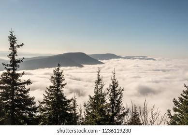 Moravskoslezske Beskydy mountains scenery from Lysa hora hill in Czech republic with clear sky and only few highest hills above mist level during autumn