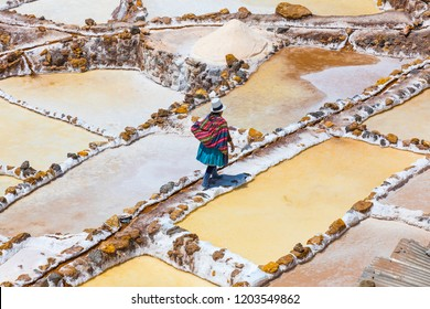 Moray Peru September 14 2018 A quechua woman is going home after a day passed working in saltpans of Moray. The extracted salt is sold to cattle farmers.