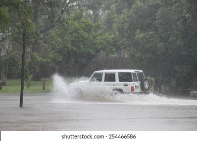 MORAYFIELD, AUSTRALIA - FEBRUARY 21: Cars driving accross flooded roadway caused by Cyclone Marcia on Feburay 21, 2015 in Morayfield, Australia