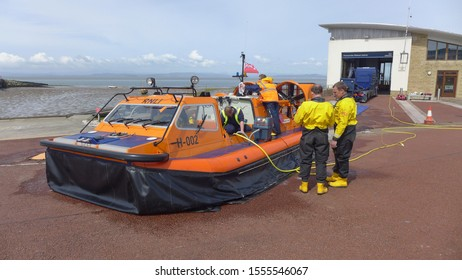 Morcambe, Lancashire, England - December 5 2018: Lifeboat crew clean down the Morcambe lifeboat station hovercraft, the hurley flyer, after an exercise in the bay, three-quarter view