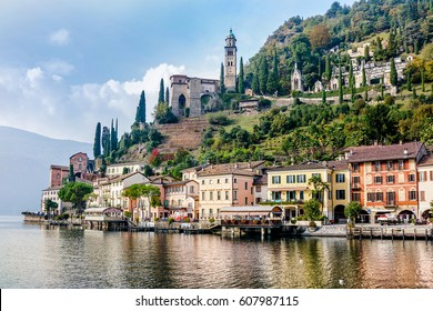 "MORCOTE, SWITZERLAND - OCTOBER 18, 2016 : Waterfront voew of Morcote village on Lake Lugano, Switzerland. Morcotte is considered  "" The Pearl of Cerasio""."