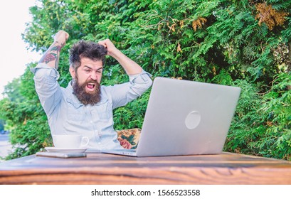 The more bet is the more winning will be. Happy hipster celebrating winning bet. Gamer making his bet in online casino with laptop computer. Bearded man placing bet in casino game.