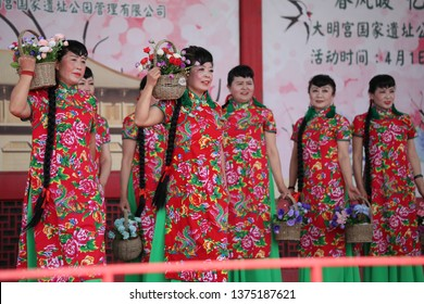 More and more elderly Chinese wear traditional qipao to perform costume shows at the daming palace national heritage park in xi 'an, capital of northwest China's shaanxi province, April 5, 2019.