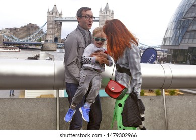 More London Riverside, Thames River Embankment, near Tower Bridge, London SE1 2FF, United Kingdom, 15 June 2019. Happy family on a walk.