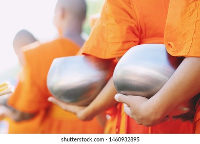 More monks with hand holding give alms bowl which came out of the offerings in the morning at Buddhist temple, Culture Heritage Site tradition and Religion Buddhism ,South east asia.