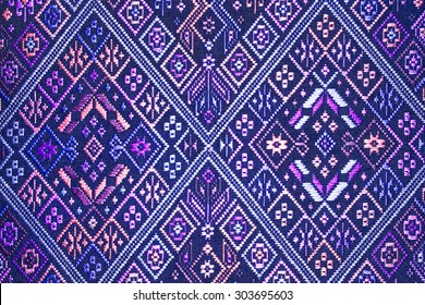 More than 100 years old colorful thai handcraft peruvian style rug surface old vintage torn conservation Made from natural materials Chemical free close up.