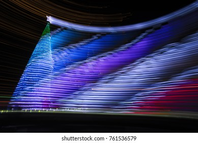 More than 6,000 bottles made of Christmas tree.The effects of turning the camera when shooting.Abstract Light Painting at night - Light Art Photography