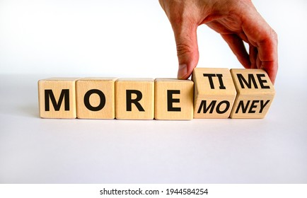 More time or money. Businessman turns wooden cubes and changes words 'more money' to 'more time' or vice versa. Beautiful white background, copy space. Business, more time or money concept. - Shutterstock ID 1944584254