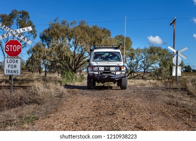 Moree, Australia - June 08, 2009: A 4WD vehicle crosses over a train line in Moree a major agricultural region in New South Wales, Australia.
