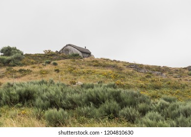 "Moreira Do Rei / Fafe / Portugal - 08-06-2018: Casa do Penedo, a house built between huge rocks. Commonly considered one of the strangest houses in the world. Also known as ""The Flintstones House"""